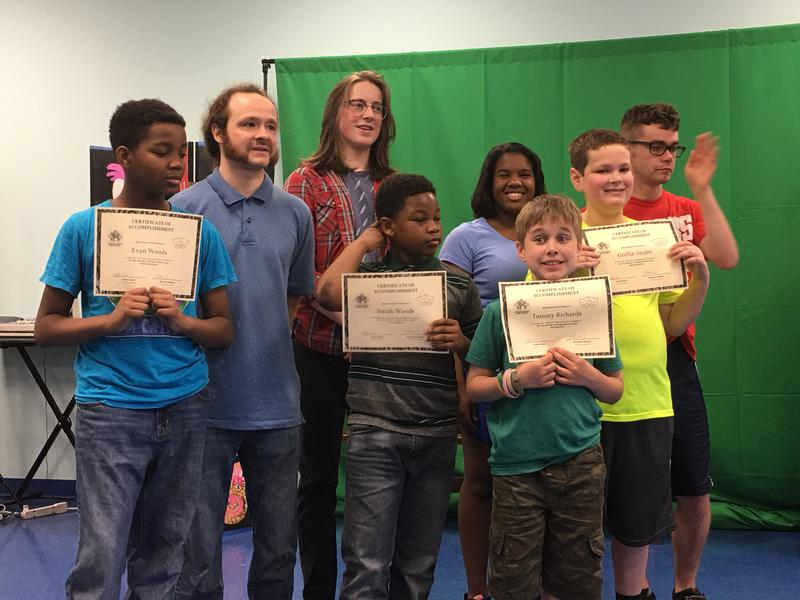 Students receiving Certificates of Accomplishment in a CADA class.